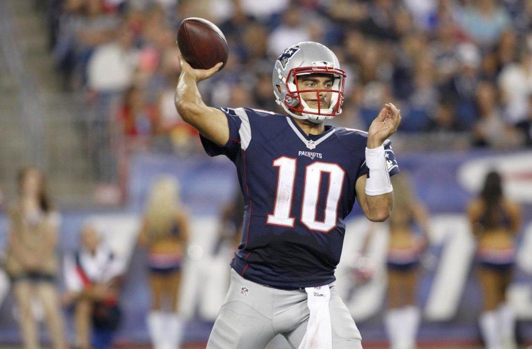 5915ae4e7 ... New England Patriots quarterbacks Tom Brady (12) and Jimmy Garoppolo (10)  warm Jimmy Garoppolo Trade ...